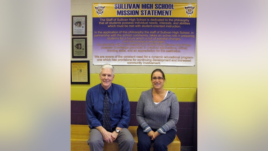"In this Wednesday, Feb. 13, 2013 photo, Sullivan High School principal David Springer, left, and assistant principal Sarah Hannon pose in the school in Sullivan, Ind. Students and staff at the school are trying to distance themselves from the media frenzy over one local group's plea for a ""traditional"" prom that would ban gay teens. (AP Photo/Pam Engel)"