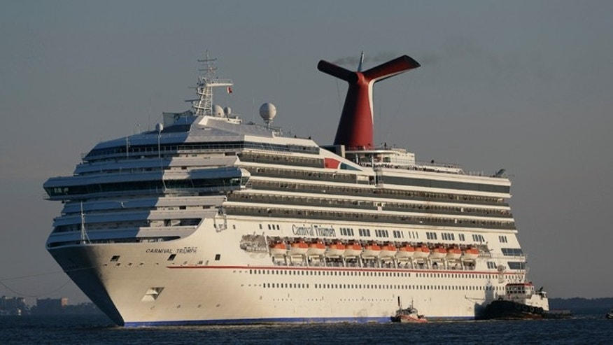 Feb. 14, 2013: In this file photo the cruise ship Carnival Triumph is towed into Mobile Bay near Dauphin Island, Ala.
