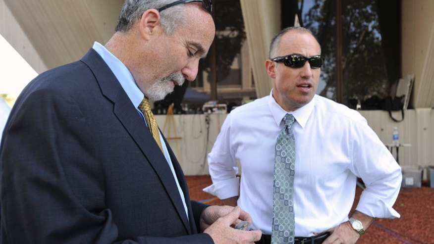In this Sept. 6, 2012 file photo, Joel Brodsky, left, and Steven Greenberg, attorneys for former Bolingbrook police officer Drew Peterson, confer outside the Will County Courthouse in Joliet, Ill., during the jury deliberations in Peterson's murder trial. The open lawyerly warfare between Brodsky, the lead counsel and co-counsel Greenberg, who also played a central role in the high-profile case, comes to a head Tuesday, Feb. 19, 2013, at a hearing where a judge will decide if Peterson should get a new trial on grounds that the lead trial attorney allegedly did a shoddy job. (AP Photo/Paul Beaty, File)