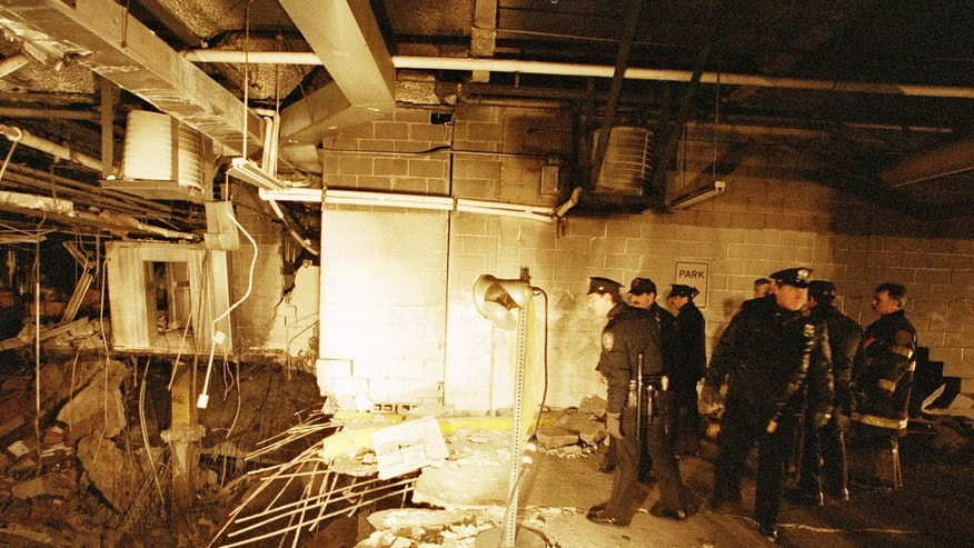 FILE - In this file photo of Feb. 27, 1993, police and firefighters inspect the bomb creater inside an underground parking garage of New York's World Trade Center the day after an explosion tore through it. Twenty years ago next week, a group of terrorists blew up explosives under one of the towers, killing six people and ushering in an era of terrorism on American soil.(AP Photo/Richard Drew, File)