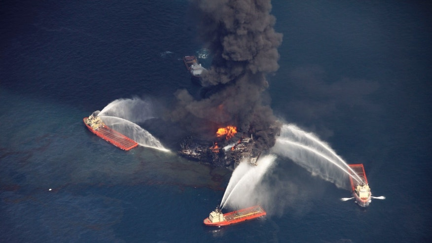 FILE - In this aerial file photo madeWednesday, April 21, 2010 in the Gulf of Mexico, more than 50 miles southeast of Venice on Louisiana's tip, an oil slick is seen as the Deepwater Horizon oil rig burns. Nearly three years after the deadly rig explosion in the Gulf of Mexico triggered the nation's worst offshore oil spill, a federal judge in New Orleans is set to preside over a high-stakes trial for the raft of litigation spawned by the disaster on Monday Feb. 25, 2013. (AP Photo/Gerald Herbert, file)