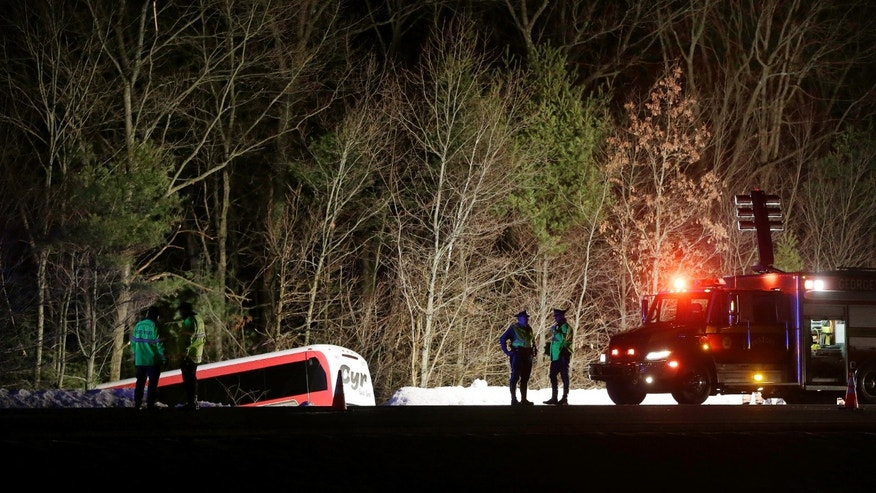 Feb. 26, 2013: Police work at the scene in Georgetown, Mass., where a bus carrying University of Maine basketball players crashed on Route 95, north of Boston, injuring the driver and several students.