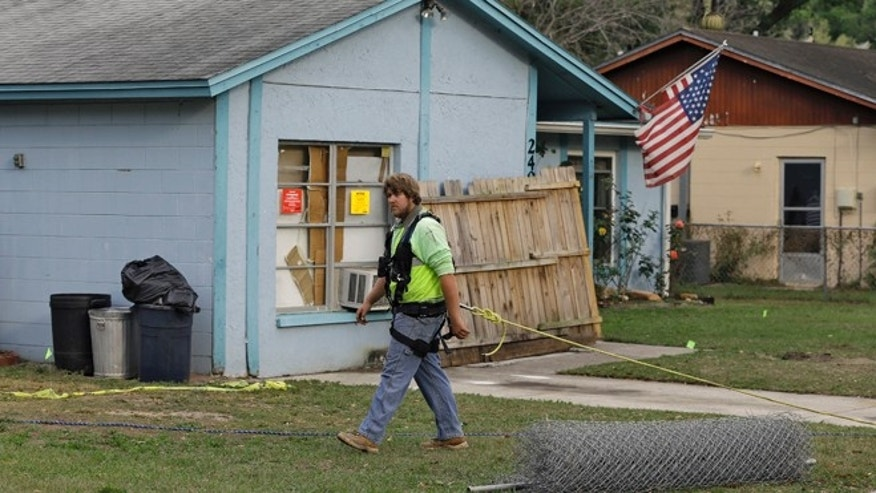 March 2, 2013: An engineer, tethered with a safety line, walks in front of a home where a sinkhole opened up underneath a bedroom late Thursday evening and swallowed a man in Seffner, Fla.  Jeffrey Bush, 37, was in his bedroom Thursday night when the earth opened and took him and everything else in his room. Five other people were in the house but managed to escape unharmed. Bush's brother jumped into the hole to try to help, but he had to be rescued himself by a sheriff's deputy.