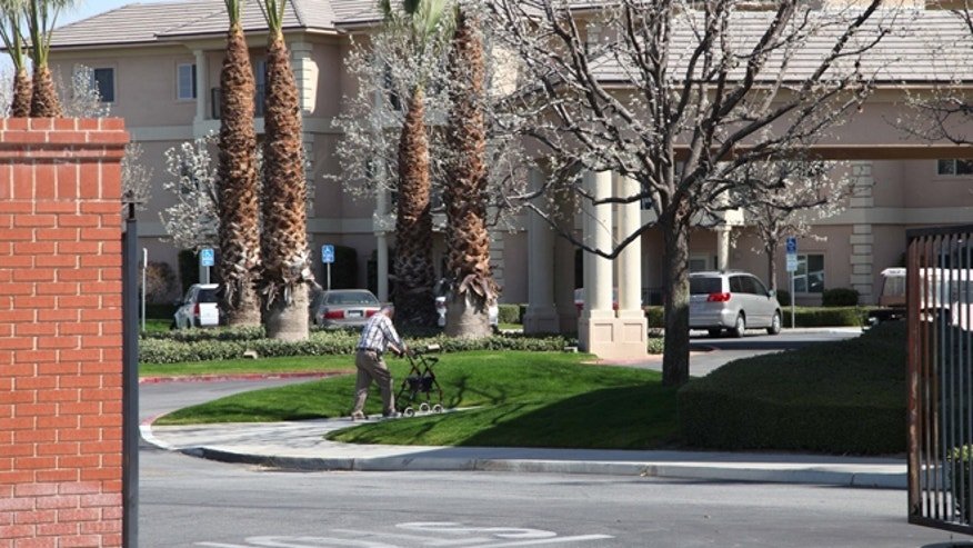 March 4, 2013: A man walks near the main gate of Glenwood Gardens in Bakersfield, Calif., where an elderly woman died after a staff member refused to perform CPR on her last week.