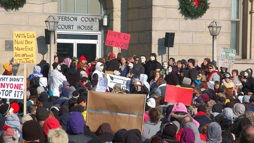 Jan. 5, 2013: This file photo shows activists from the online group KnightSec and Anonymous protest at the Jefferson County Courthouse in Steubenville, Ohio.