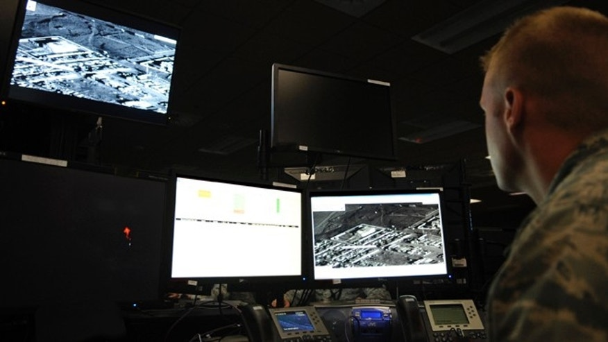 This undated photo released by the U.S. Air Force shows the operations center for the 497th Intelligence, Surveillance and Reconnaissance Group at Langley Air Force Base in Hampton, Va. Though the gritty combat in Afghanistan is thousands of miles away, analysts in the cavernous room at Langley relive the explosions, the carnage, and the vivid after-battle assessments of the bombings over and over again. And the repeated exposure to death and destruction rolling across their computer screens is taking its own special toll on their lives. So for the first time, an Air Force chaplain and a psychologist are walking the floor of the operations center offering counseling and stress relief to the analysts.