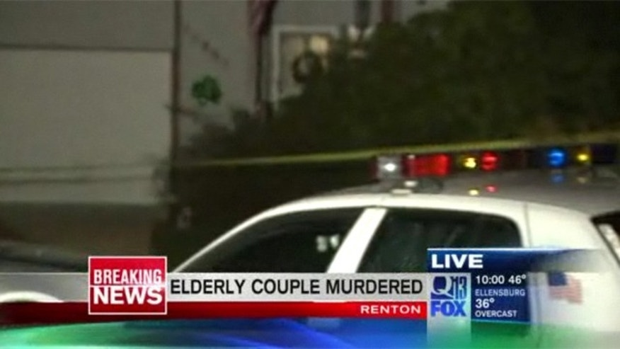 Police surround a home after an elderly couple was found dead.
