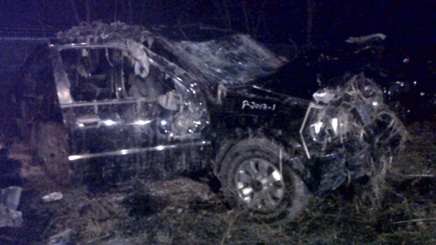March 10, 2013: This photo shows a Honda Passport that crashed into a guardrail and flipped over into a swampy pond Sunday morning in Warren, Ohio. Highway Patrol officials say speed was a factor in the violent early morning crash of the vehicle that killed six teenagers in northeast Ohio.