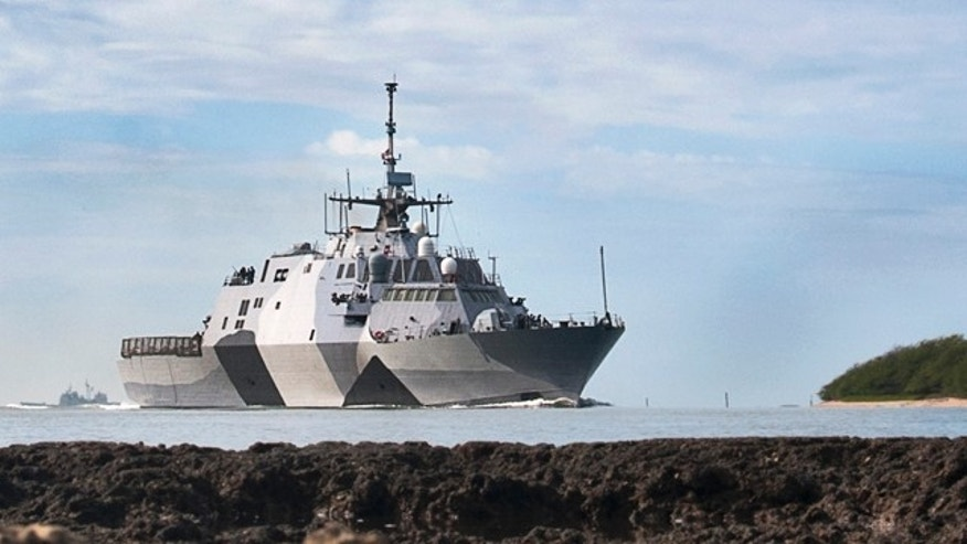 In this photo provided by the U.S. Navy, the USS Freedom littoral combat ship pulls into Pearl Harbor, Hawaii.