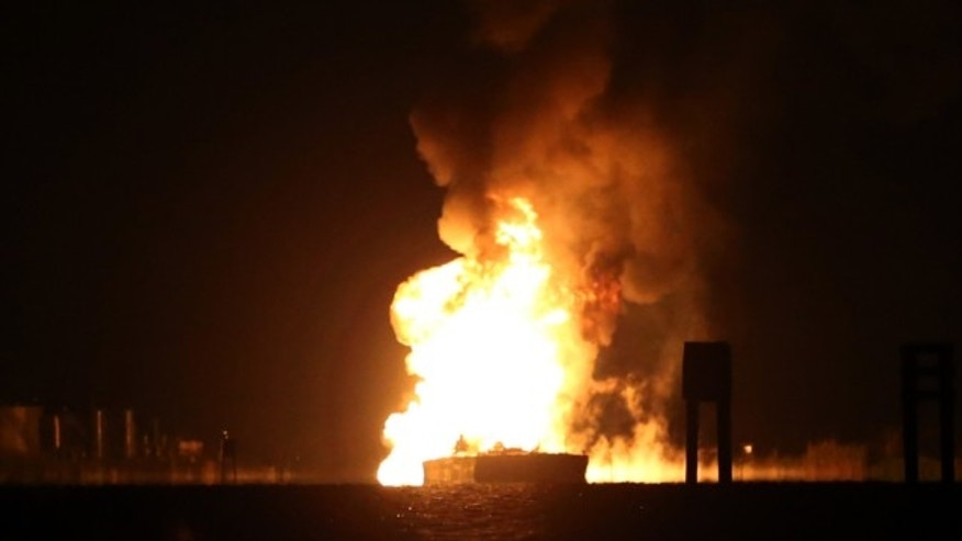 A tugboat and barge are engulfed in flames after hitting a natural gas pipeline in Bayou Perot about two miles south of lower Lafitte, Louisiana.