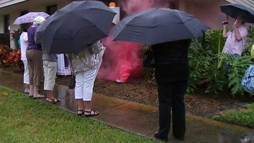 Members of a church in Sarasota sent up their own smoke signals Tuesday -- not black or white, but pink.