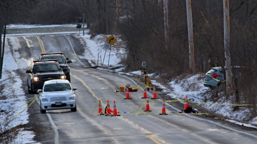 March 15, 2013: New York State Police investigate a car involved in a fatal carjacking on Verplank Road, Clay, N.Y.
