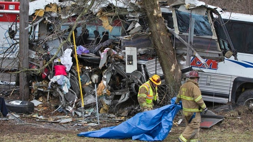 March 16, 2013: Rescue personnel remove a tarp after a tour bus crash on the Pennsylvania Turnpike near Carlisle, Pa.  Lacrosse players from Seton Hill University and three coaches were among the 23 people aboard when the bus crashed at about 9 a.m., turnpike spokeswoman Renee Colborn said.