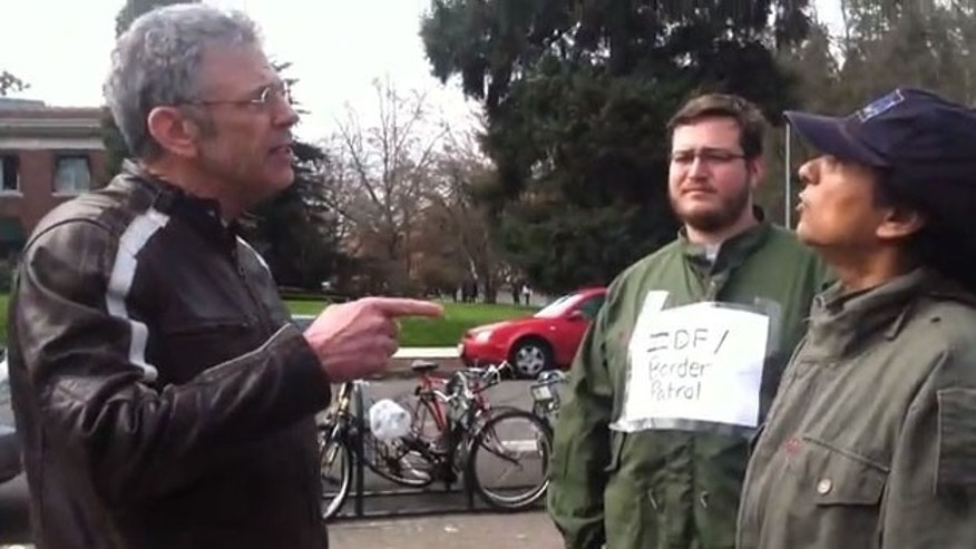 Adjunct Law Professor James Olmstead (left) was fired from the University after a heated exchange with student protesters