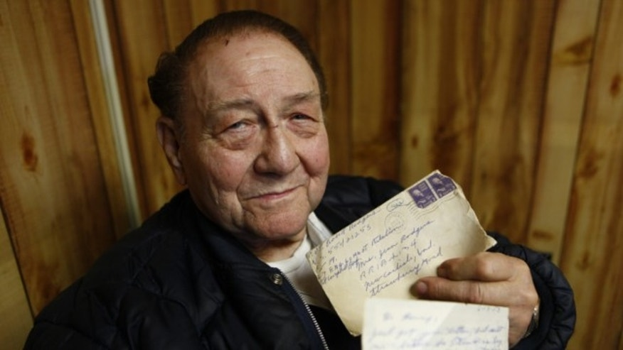March 15, 2013: Bob Rodgers, 79, displays the letter and envelope he mailed to his wife, Jean, on June 13, 1953, when he was undergoing basic training at Fort Campbell, Ky.
