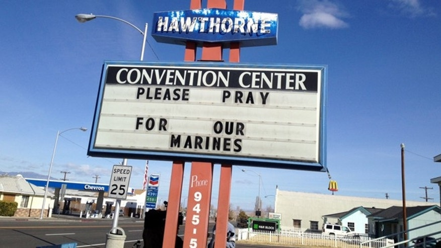 March 19: A Convention Center billboard asks people to pray for the Marines that will killed in Hawthorne, Nev.