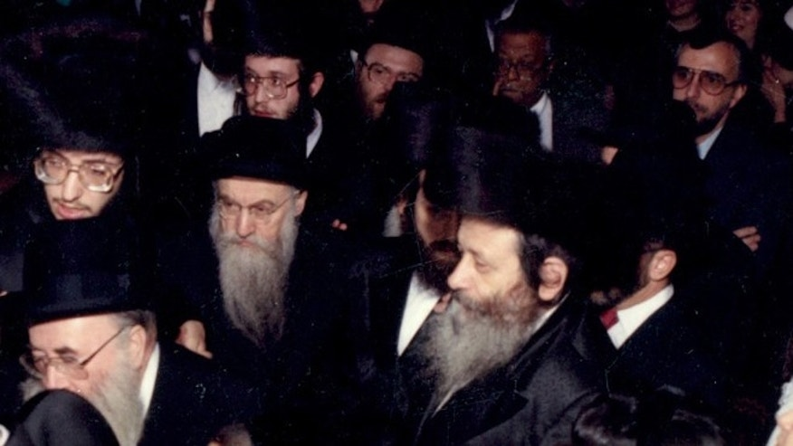 Nov. 1, 1989: In this photo provided by vosizneias.com, courtesy of Isaac Abraham, Rabbi Chaskel Werzberger, center right, attends a wedding in the Williamsburg section of the Brooklyn borough of New York.