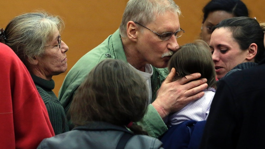 March 21, 2013: David Ranta kisses a family member after Judge Miriam Cyrulnik freed him, in state Supreme Court in Brooklyn, New York.