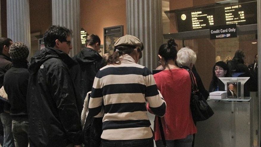 March 19, 2013: Visitors to the Metropolitan Museum of Art in New York wait in line to buy admission tickets.