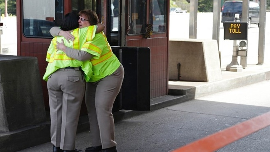 March 26: Toll taker Dawnette Reed, left, is embraced by co-worker Marsha Brandhorst, right, at the end of her shift on the Golden Gate Bridge.