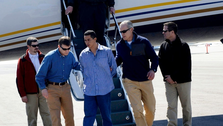 March 27, 2013: In this photo provided by the FBI Denver Special Agents escort Rivera Gracias, one of the FBIs Ten Most Wanted Fugitives,&quot&#x3b; off a plane in Denver. Gracias was wanted in Jefferson County in the slaying of 69-year-old Richard Limon, whose beaten and stabbed body was found dumped along a roadside in 2011.