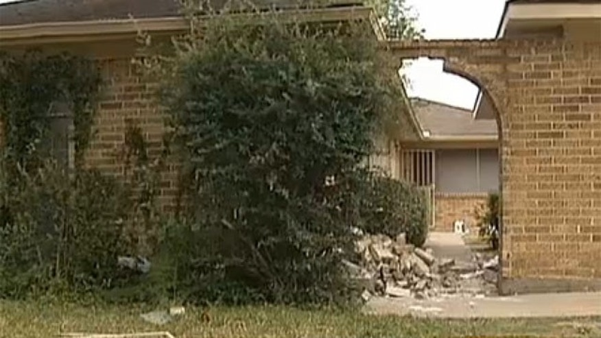 Mar. 28, 2013: A house sustained damage after a woman allegedly ran over another woman.