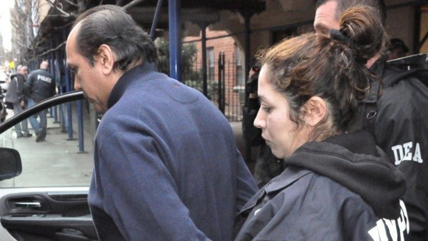 March 26, 2013: Officers from the New York City Police Department and the U.S. Drug Enforcement Administration take Dr. Hector Castro into custody.