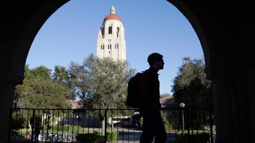 FILE: Stanford University student walks in front of Hoover Tower in Palo Alto, Calif.