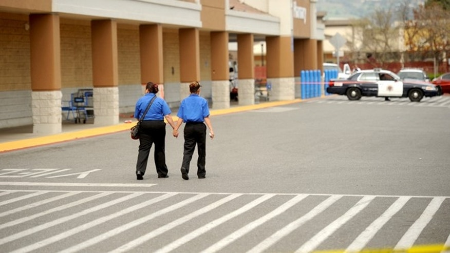 Unidentified women leave a San Jose, Calif., Walmart after a motorist drove through a store entrance and began assaulting shoppers on Sunday, March 31, 2013. Four people sustained injuries during the attack according to a police spokesman.