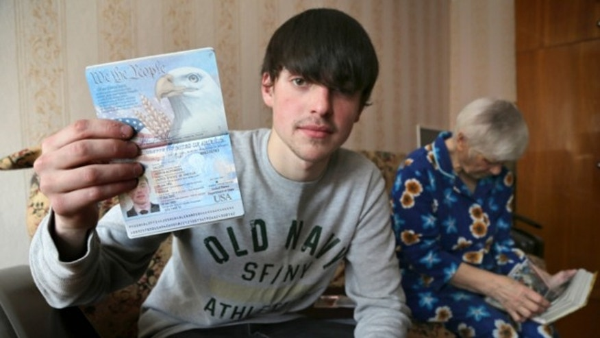 March 20, 2013: Alexander Abnosov shows his American passport to journalists in the Volga river city of Cheboksary, Russia.