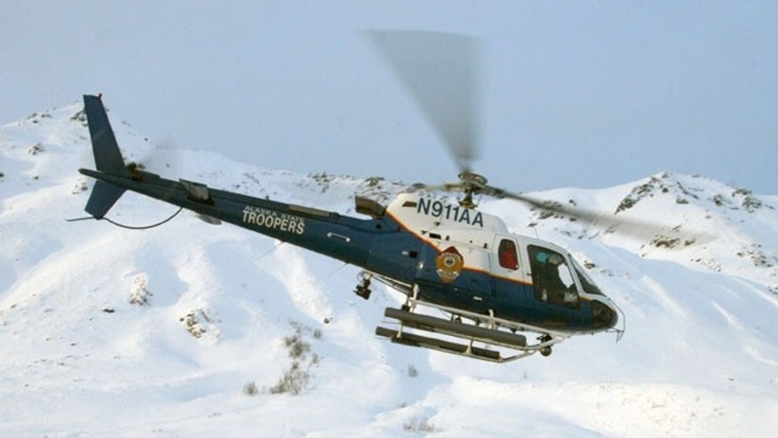 This 2008 image provided by the Alaska State Troopers shows their helicopter which crashed.