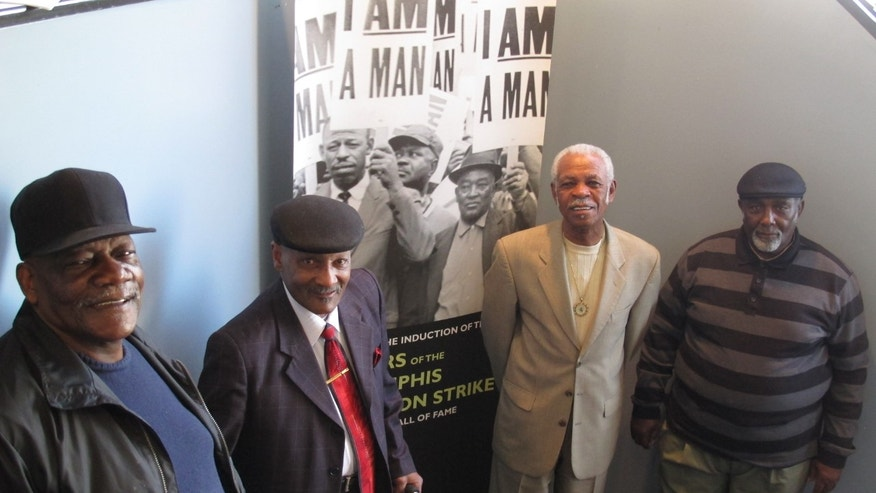 "Alvin Turner, the Rev. Leslie Moore, Elmore Nickleberry and Baxter Leach, from left, pose for a photo at the headquarters of Local 1733 of the American Federation of State, County and Municipal Employees on Thursday, March 14, 2013 in Memphis, Tenn. The men participated in a sanitation workers strike in 1968 that drew the support of civil rights leader Martin Luther King Jr., who was assassinated in Memphis on April 4 of that year. The poster includes the strike's rallying cry, ""I am a man."" (AP Photos/Adrian Sainz)"