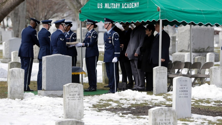 Joint Base McGuire-Dix-Lakehurst Honor Guard members fold a flag during a burial service at the West Point Cemetery on Friday, March 22, 2013, in West Point, N.Y. The service was for Maj. Gen. Robert Strong and wife Virginia Strong. Graves of soldiers from every U.S. war make this small plot of the land the most hallowed ground on the nation's the most venerable military academy. And after 196 years and more than 8,000 souls, it's close to full. (AP Photo/Mike Groll)