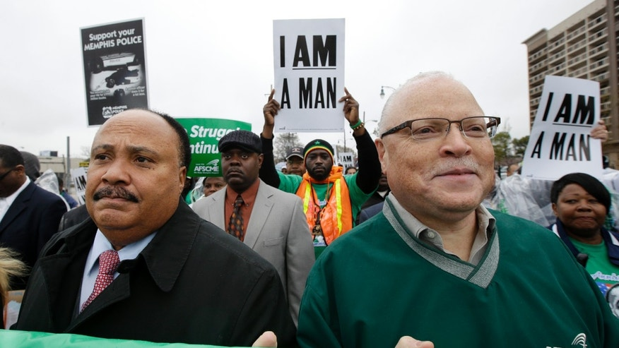 Martin Luther King III, left, and Lee Saunders, right, president of the American Federation of State, County and Municipal Employees,  take part in a march to the National Civil Rights Museum on Thursday, April 4, 2013, in Memphis, Tenn. Labor groups marched to call for better conditions on the 45th anniversary of the killing of King's father, Dr. Martin Luther King Jr., who as assassinated April 4, 1968, while he was in Memphis to support striking sanitation workers. (AP Photo/Mark Humphrey)
