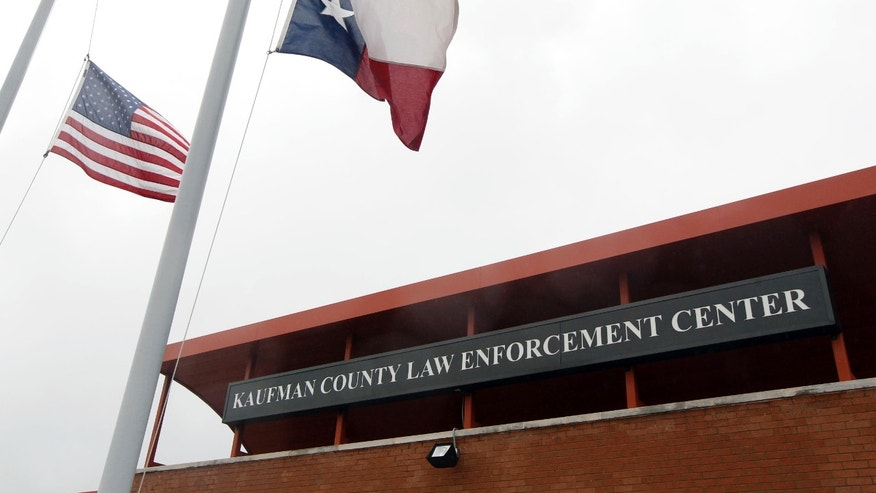 Flags fly at half-staff at the Kaufman County Law Enforcement Center, on Wednesday, April 3, 2013 in Kaufman, Texas, after the murders of District Attorney Mike McLelland and his wife, Cynthia. (AP Photo/The Dallas Morning News, Michael Ainsworth)  MANDATORY CREDIT; MAGS OUT; TV OUT; INTERNET OUT; AP MEMBERS ONLY