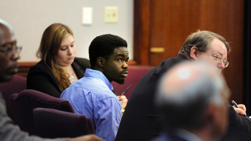 De'Marquise Elkins, center, listens to proceedings during his bond hearingwhile sitting next to his lawyer Defense Attorney Kevin Gough, right, Friday April 5, 2013 in Brunswick, Ga. Authorities charged Elkins with malice murder for the March 21 slaying of 13-month-old Antonio Santiago.  Police say the child was shot as Elkins and a younger teenager tried to rob the boy's mother. The judge denied Elkins' request for bond Friday, saying he's concerned Elkins might flee. (AP Photo/Stephen Morton)