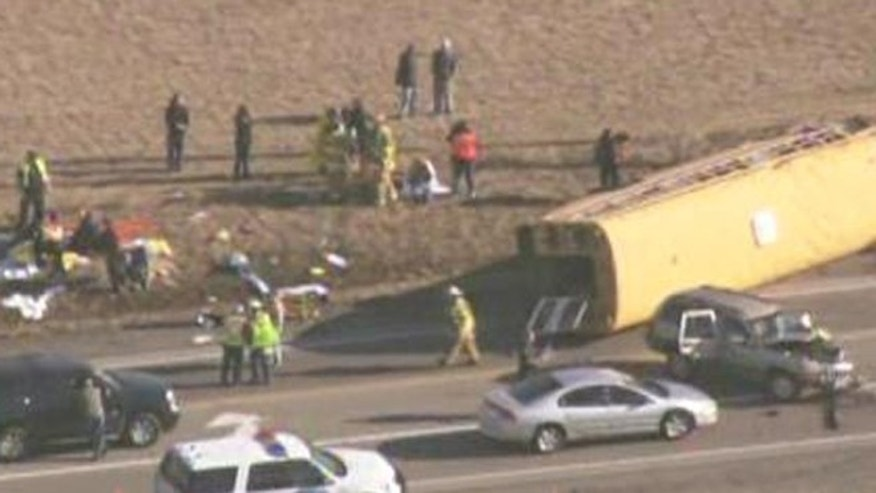 This April 5, 2013 screen grab shows the scene of an accident in Illinois. A bus carrying 25 students overturned and was involved in an accident with at least 2 other vehicles.
