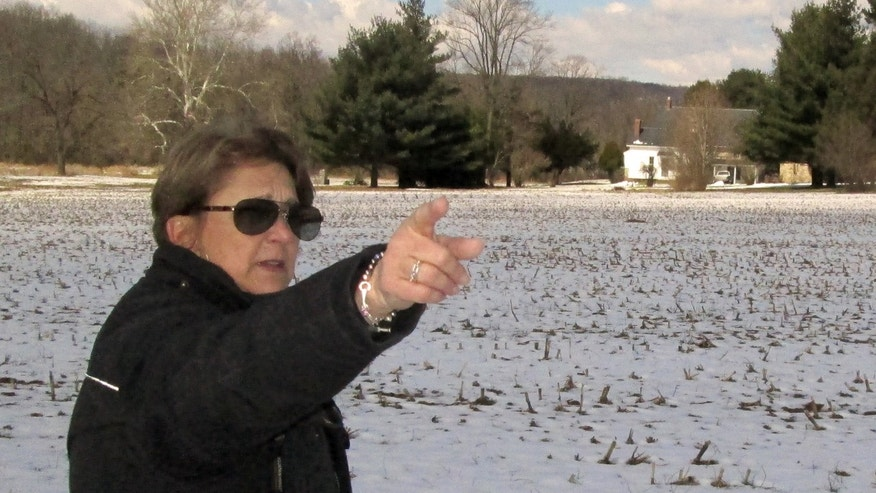 March 26, 2013: In this photo Carol Tanzola, president of Friends of Camp Security, points out the property on a 47-acre parcel, located about four miles east of York, Pa.
