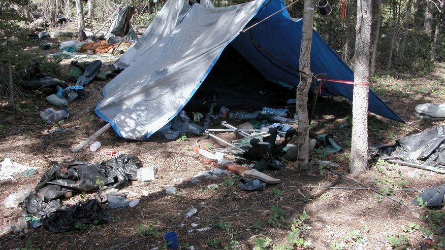 FILE - This undated file photo provided by the Iron County Sheriff's Office shows a remote camp littered with supplies and trash, believed to have been left behind by Troy James Knapp, in the southern Utah wildness near Zion National Park. Authorities say they have arrested Knapp, a survivalist suspected of burglarizing Utah cabins and evading law enforcement for years. (AP Photo/Iron County Sheriff, File)