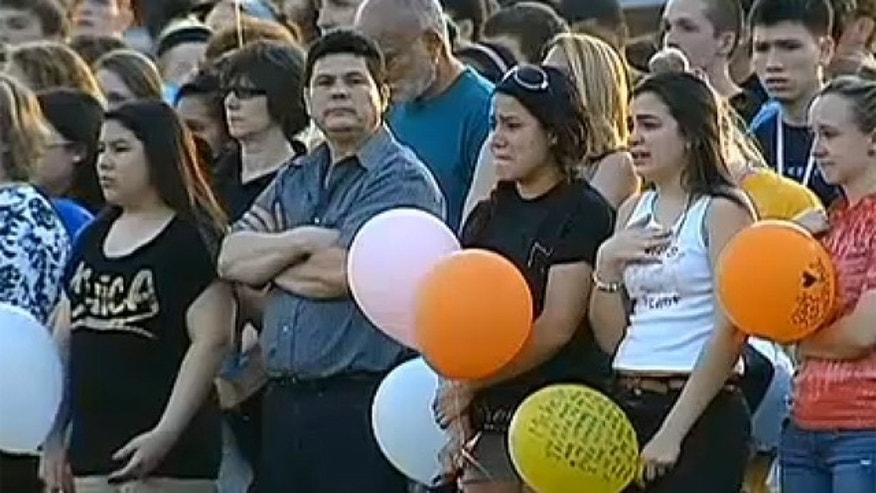 April 9, 2013: Friends of Michelle Miller gather to remember her at a vigil.