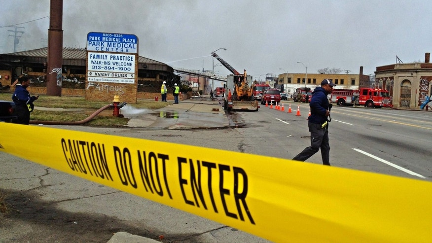 April 9, 2013: Caution tape lines the scene as a fire burns at Park Medical Centers building in Detroit. Two people remain unaccounted for in the gutted medical office building after a possible shooting and intentionally set fire, police said.