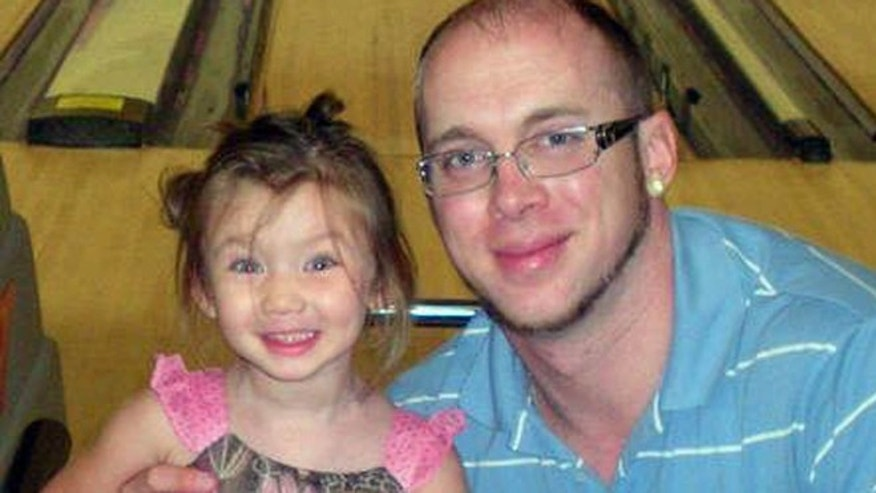 In this undated photo made available by Jordan Arwood, shows him with his daughter Chloe Jade Arwood.