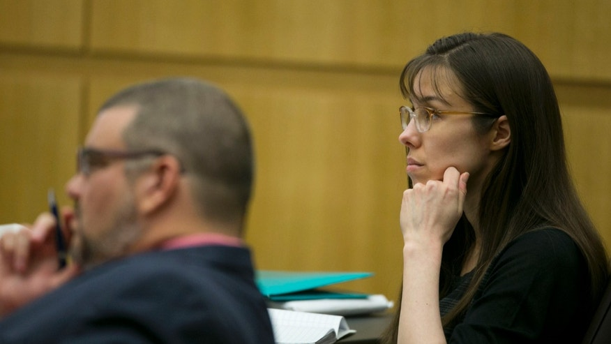 April 11, 2013: Defendant Jodi Arias listens during redirect of Alyce LaViolette, a domestic violence expert, during Arias's trial at Maricopa County Superior Court in Phoenix.