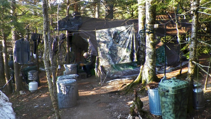 This photo released Wednesday, April 10, 2013 by the Maine Department of Public Safety shows a camp in a remote, section of Rome, Maine, where authorities believe Christopher Knight lived like a hermit for decades.  Knight, known as the North Pond Hermit, was arrested Thursday, April 4, 2013, while stealing food from another camp in Rome.  Authorities said he may be responsible for more than 1,000 burglaries.  (AP Photo/Maine Department of Public Safety)