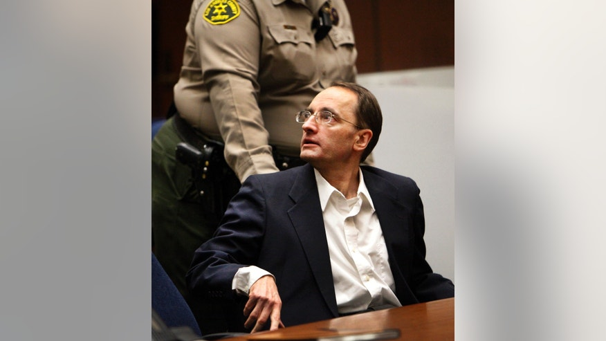 Christian Gerhartsreiter is led away by a Sheriff's deputy in a Los Angeles Superior Courtroom after a jury delivered a guilty verdict  on April 10, 2013 in Los Angeles.  The jury found Gerhartsreiter guilty in the death of a California man nearly three decades ago.  The verdict was reached Wednesday after the jury deliberated about a day.  Testimony in the cold-case trial of Gerhartsreiter focused on the discovery of the bones of John Sohus long after he and his wife disappeared from his mother's home in San Marino, a wealthy Los Angeles suburb.  The defendant, a German immigrant with delusions of grandeur, rented a cottage at the Sohus home in 1985 then disappeared about the same time as Sohus and his wife Linda who was never found.  (AP Photo/Los Angeles Times, Al Seib)  NO FORNS; NO SALES; MAGS OUT; ORANGE COUNTY REGISTER OUT; LOS ANGELES DAILY NEWS OUT; VENTURA COUNTY STAR OUT; INLAND VALLEY DAILY BULLETIN OUT; MANDATORY CREDIT, TV OUT