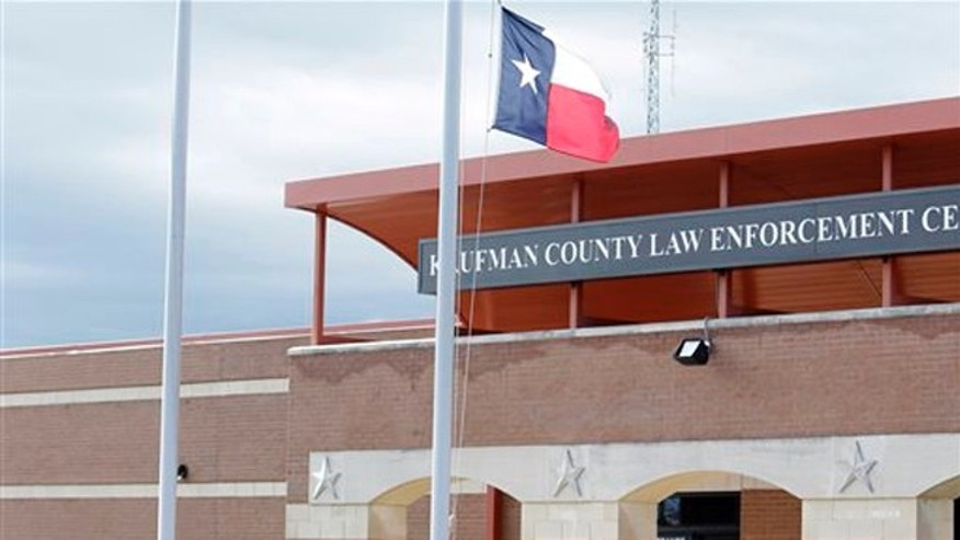 March 31, 2013: A sheriff's official lowers the Texas state flag to half-staff at the Kaufman County Law Enforcement Center in Kaufman, Texas.