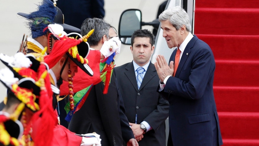 U.S. Secretary of State John Kerry, right, greets upon his arrival at Seoul military airport in Seongnam, South Korea, Friday, April 12, 2013. Kerry is traveling directly into a region bracing for a possible North Korean missile test and risking that his presence alone could spur Pyongyang into another headline-seeking provocation. (AP Photo/Lee Jin-man)