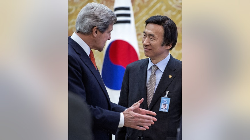 U.S. Secretary of State John Kerry, left, and South Korea Foreign Minister Yun Byung-se share a few words while waiting for a group meeting with South Korean President Park Geun-hye at the presidential Blue House in Seoul, Friday, April 12, 2013.  Kerry is making his first-ever visit to Seoul amid strong suspicion that North Korea may soon test a mid-range missile.  (AP Photo/Paul J. Richards, Pool)