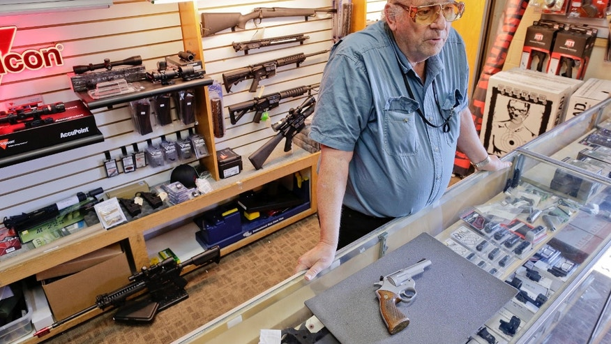 George Bramlett, owner of the Bargain Pawn shop talks about the auction of former LAPD police officer Christopher Dorner's Astra 960 .38 Special revolver, Friday, April 12, 2013, in Las Vegas. Dorner sold the revolver to Bramlett's pawn shop in January. Bramlett says that he will offer money from the sale of the gun to help families of Dorner's victims. (AP Photo/Julie Jacobson)