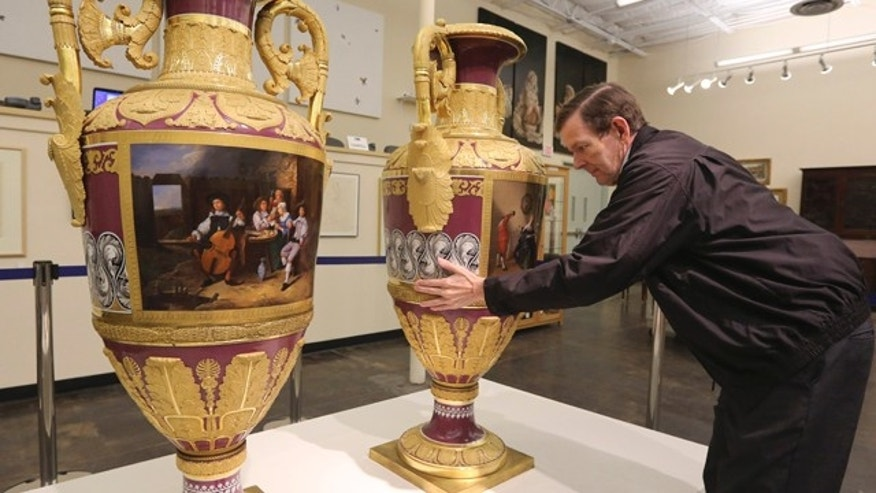 April 4, 2013: Jerry Holley, executive vice president of Dallas Auction Gallery, rotates a rare Russian vases made in 1833 by Russia's Imperial Porcelain Factory and on display at the gallery in Dallas.